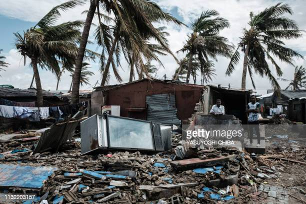 An owner stays at his destroyed bar after the cyclon Idai hit near the beach in Beira Mozambique on March 23 2019 The death toll in Mozambique on...