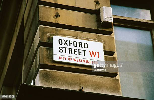 an oxford street sign on the side of a building - rua oxford - fotografias e filmes do acervo