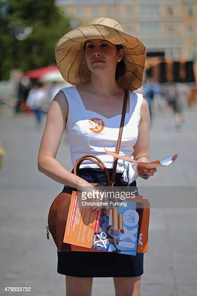 An Oxi supporter gives out campaign leaflets in Syntagma Square on July 3 2015 in Athens Greece The 'Yes' and 'No' supporters in Greece are set to...