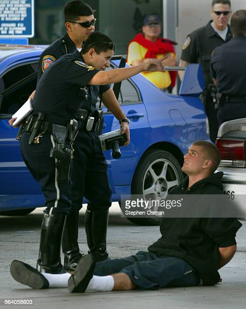 An Oxnard police officer talks with the car theft suspect Stolen car is in background A pursuit ended in several accidents in south Oxnard this...