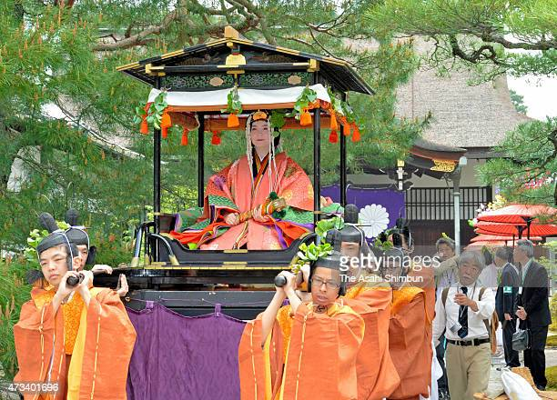 """An """"Oyoyo"""" float carrying the """"Saio-dai"""" queen wearing """"junihitoe,"""" the layered formal kimono of Heian Period court ladies march on during the Aoi..."""