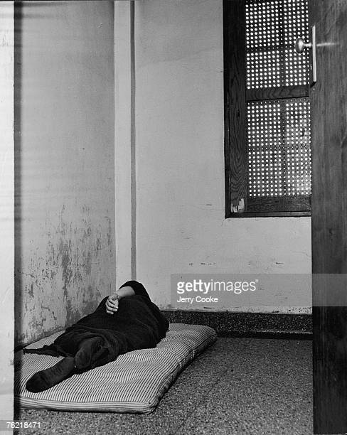 An patient sleeps on a thin mattress on the floor of an otherwise bare room in the Cleveland State Mental Hospital, Cleveland, Ohio, 1946.