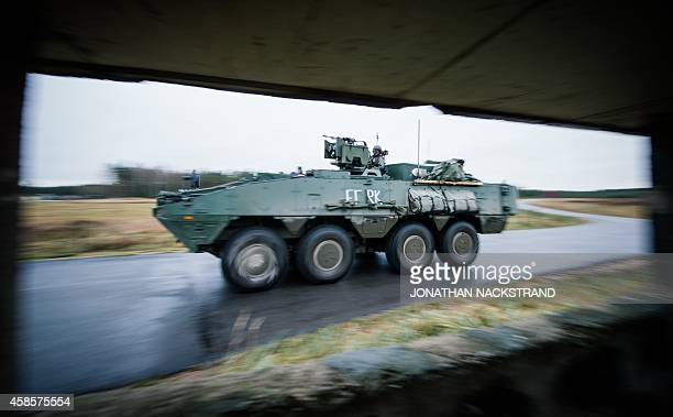 An Patria XA360 AMV from the Swedish Armed Forces patrols at Hagshult Airbase part of the Forward Operation Base of the NBG about 240km NorthEast of...