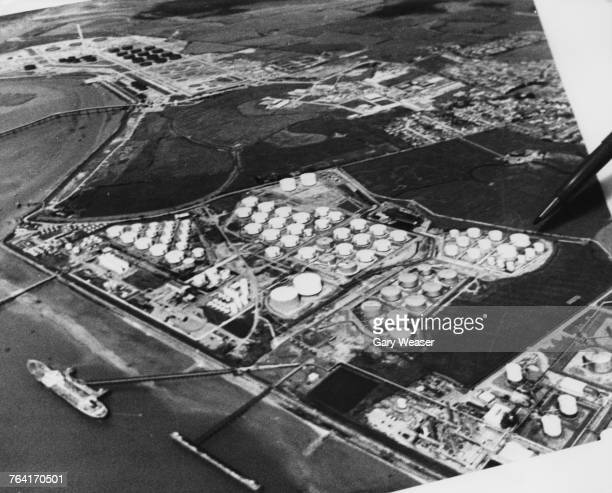 An pen pointing to an aerial photograph to indicate the placing of a bomb by the Provisional Irish Republican Army at a Texaco oil terminal on Canvey...