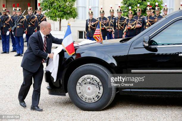 An person cleans the car of US President Donald Trump at the Elysee Presidential Palace on July 13 2017 in Paris France As part of the commemoration...