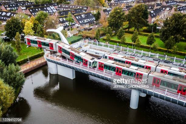 TOPSHOT An photo taken in Spijkenisse on November 2 2020 shows a metro train that shot through a stop block at De Akkers metro station without making...