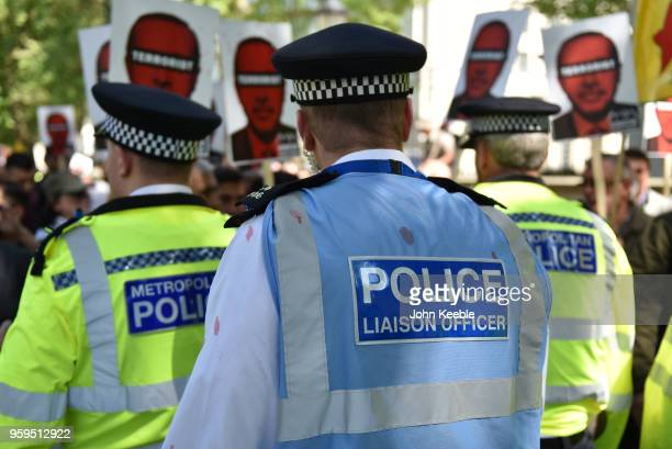 An Police liaison officer attends as antiErdogan protesters stage a demonstration outside Downing Street as Turkish President Recep Tayyip Erdogan...