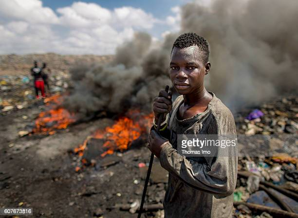 An Portrait of an African teenager on the biggest electronic scrap yard of Africa in Agbogbloshie a district of the Ghanaian capital Disused...
