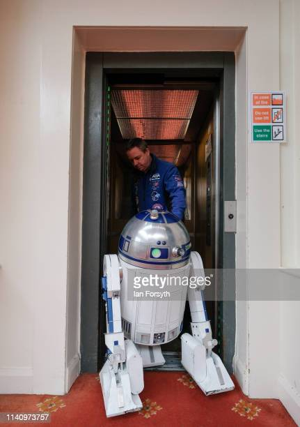An R2 unit based on the Star Wars movie character is guided into a lift on the second day of the Scarborough Sci-Fi weekend held at the seafront Spa...