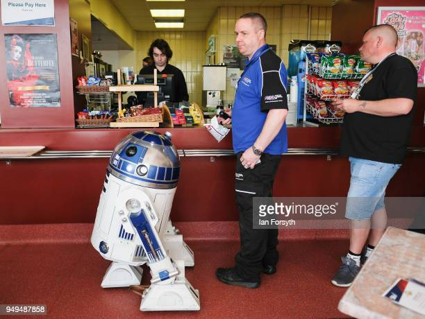 An R2 unit from Star Wars waits in line at a cafe during the Scarborough Sci-Fi event held at the seafront Spa Complex on April 21, 2018 in...