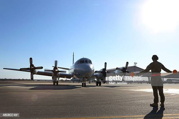 An RAAF P3 Orion returns from the first flight today Pearce Air Base on March 27, 2014 in Perth, Australia. New images overnight have been released...