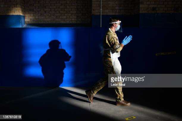 An RAF airman walks to his position at a temporary COVID-19 testing centre within The Engine House on November 25, 2020 in Merthyr Tydfil, Wales. The...