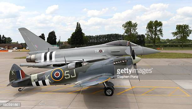 An RAF Eurofighter Typhoon and RAF Spitfire are displayed during the unveiling of the commemorative DDay Eurofighter Typhoon jet at RAF Coningsby on...