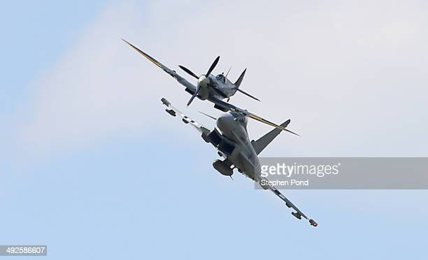 An RAF Eurofighter Typhoon and RAF Spitfire perform a flypast during the unveiling of the commemorative DDay Eurofighter Typhoon jet at RAF Coningsby...