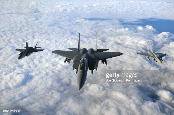 An RAF F35B Lightning stealth jet a United States Air Force F15 Strike Eagle and a French Air Force Rafale fly in formation over the English Channel...