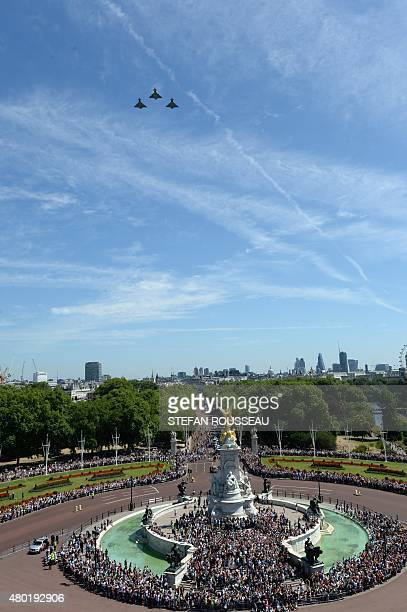 An RAF Flypast of three Typhoons flies over The Mall and Buckingham Palace to mark the 75th anniversary of the Battle of Britain in London on July 10...
