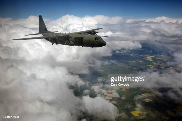 An RAF Hercules C130 flies over Wales over Wales during a practice flight after taking off from RAF Brize Norton on May 15 2012 in England Two...