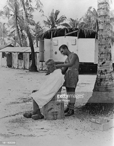 An RAF serviceman having his hair cut on Christmas Island in the Central Pacific Ocean during preparations for the Operation Grapple British nuclear...