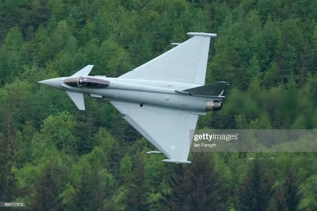 An RAF Typhoon flies over the Derwent Dam in the Upper Derwent Valley on May 16, 2018 in Sheffield, England. The Typhoon replaced a planned flight by a Lancaster bomber from the Battle of Britain Memorial Flight to mark the 100th anniversary of the Royal Air Force and the 75 anniversary of the 617 Squadron Dam busters operation during World War Two but was cancelled due to strong winds. Operation Chastise was an attack on the German dams Mohne, Edersee and Sorpe in the Ruhr Valley on 16 - 17 May 1943 by No 617 Squadron Royal Air Force, later called the Dam Busters. Using purpose built bouncing bombs developed by Barnes Wallis they used the Derwent reservoir as one of the practice locations before the attack. The flight over the dam was organised by the Royal Air Force Battle of Britain Memorial Flight and the bomber made two passes during the sortie before returning to RAF Coningsby.