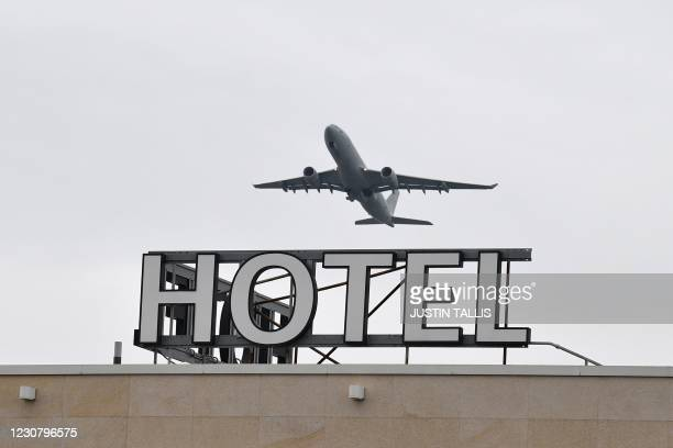 An RAF voyager airplane is seen flying over a hotel at Heathrow Airport in west London on January 26, 2021. - The British government is being urged...