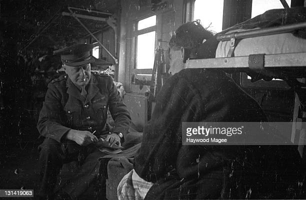 An RAMC officer making a tour of inspection of a hospital train bringing wounded veterans of the battle of El Alamein back to England 6th March 1943...