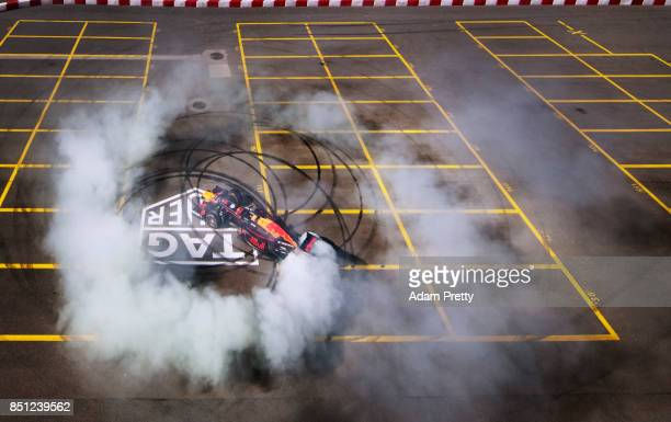 An RB8 Red Bull Racing Formula One Car piloted by Patrick Friesacher performs some burnouts at TAG Heuer Factory on September 21 2017 in La...