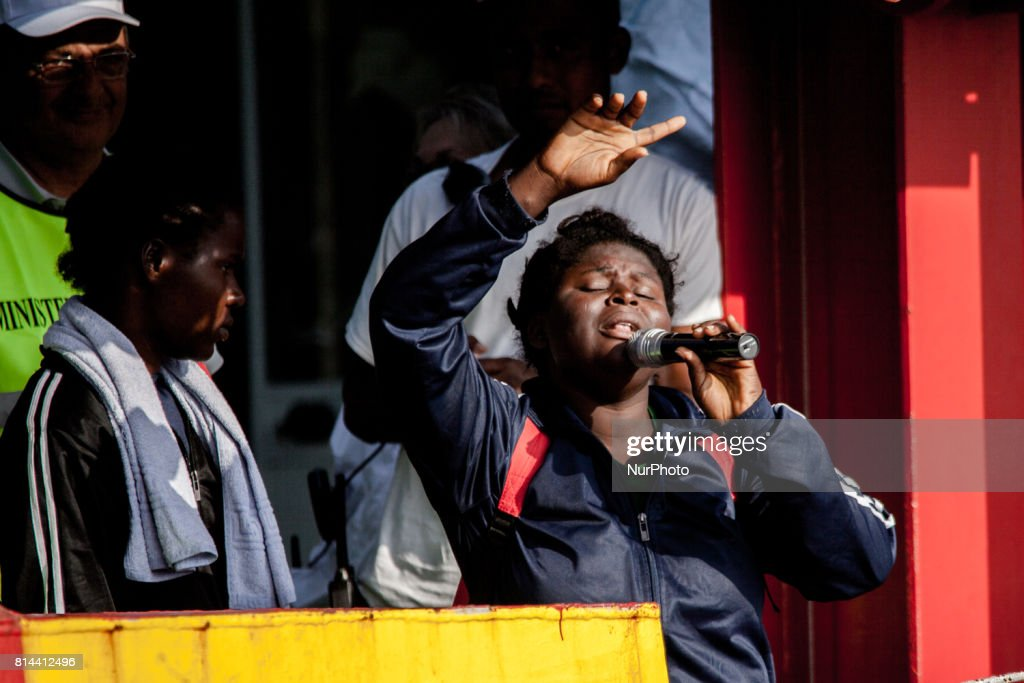 An refugee Sings song with the microphone of the ship for all the migrants. 935 Migrant landing in Salerno July on 14,2017, The Ship Vos Prudencewith 935 migrants form Subsaharian,Libia, Mali, Pakistan, Nigeria, Marocco and 118 women, 16children, 100 unaccompanied minors, 30 men with exchanges.