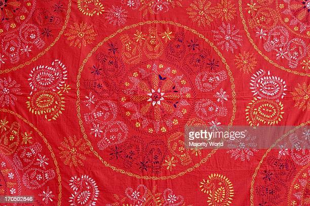 An richly embroidered piece of clothing This kind of embroidery is popularly known as kantha stitch and takes a lot of time to complete It is also...