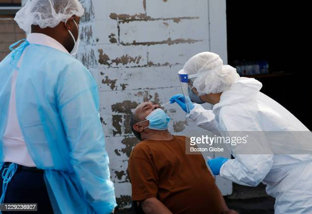 An RN administers a coronavirus test at a COVID-19 testing site set up by Harvard Street Neighborhood Health Center at Prince Hall Grand Lodge in...