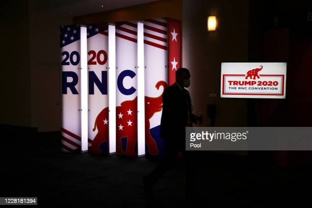 An RNC sign glows outside the Charlotte Convention Center's Richardson Ballroom where delegates will gather for the roll call vote to renominate...