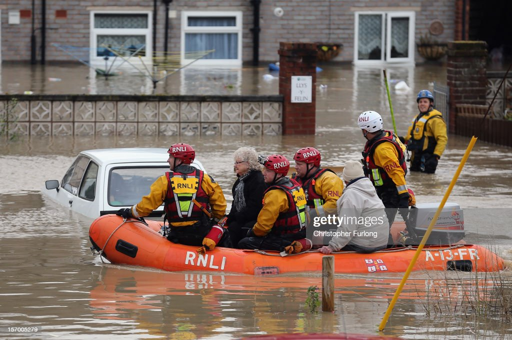 An RNLI life boat rescue residents in the flooded streets of St Asaph in North Wales after torrential overnight rain on November 27, 2012 in St Asaph, Wales. Residents in up to 500 homes in St Asaph have been advised to evacuate as flood waters continue to rise and the River Elwy breaks its banks.