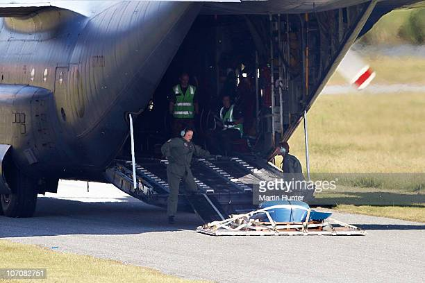 An RNZAF Hercules delivers a ventilation fan on the runway at the Greymouth Airport to be taken to the Pike River mine on November 23, 2010 in...