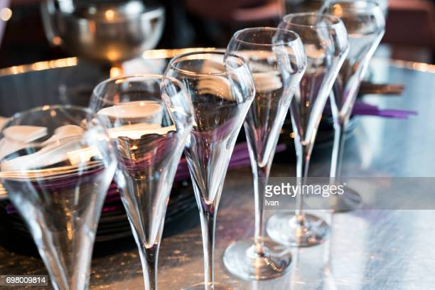 an row of champagne flutes for celebration event - gala stock pictures, royalty-free photos & images