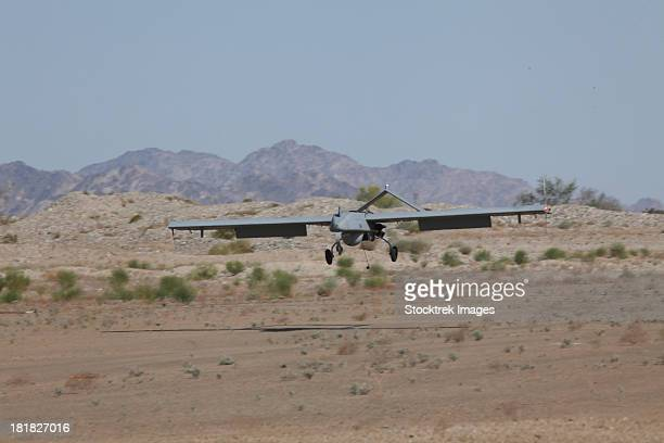 an rq-7b shadow unmanned aerial vehicle prepares to land. - military drones stock pictures, royalty-free photos & images