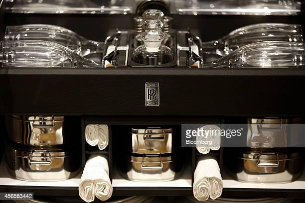 An 'RR' logo sits on a picnic hamper set inside a Rolls Royce Phantom Metropolitan luxury automobile produced by RollsRoyce Motor Cars Ltd at the...