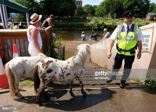 An RSPCA officer stands by the entrance ramp to the River Eden on the first day of the Appleby Horse Fair on June 7 2018 in Appleby EnglandThe fair...