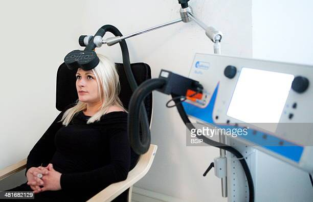 An rTMS session in the Depression Center Paris France A depressed patient receives a daily session for a 10day period TMS delivers magnetic impulses...