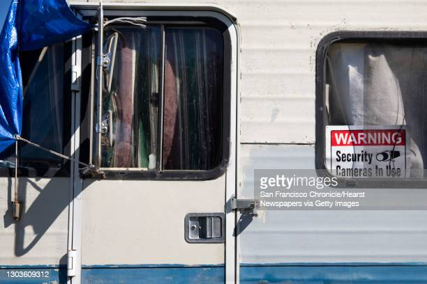 An RV is seen padlocked with warning signs for security purposes at an RV encampment along Rydin Road in Richmond, Calif. Monday, February 22, 2021....