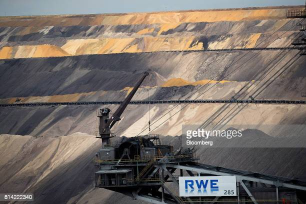 An RWE AG logo sits on a giant excavator at the Garzweiler open cast lignite mine in Garzweiler Germany on Thursday July 13 2017 German Chancellor...