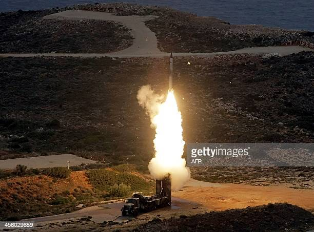 An S300 PMU1 antiaircraft missile launches during a Greek army military exercise near Chania on the island of Crete on December 13 2013 Greece is the...