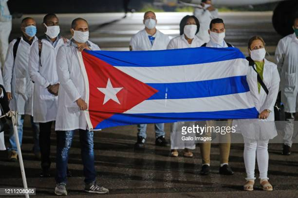 An SAA flight with a Cuban Health Brigade consisting of 217 Cuban health proffesionals arrives at Waterkloof Airforce Base on April 27 2020 in...