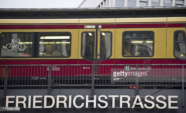 An SBahn train crosses the bridge over Berlin's Friedrichstrasse May 31 2011 AFP PHOTO / JOHN MACDOUGALL