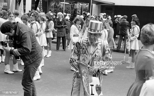 An senior adult sells themed souvenirs on 5th Avenue during the St Patrick's Day parade New York New York March 17 1979