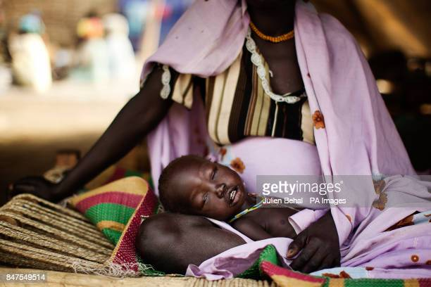 An seriously ill infant is cradled by her mother in the clinic in Doro refugee camp in BunjMaban in the Upper Nile Blue Nile state of northeastern...