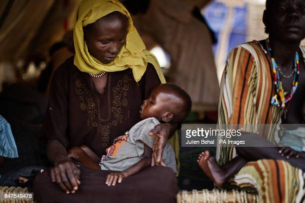 An seriously ill infant is cradled by his mother in the clinic for people from Doro refugee camp in BunjMaban in the Upper Nile Blue Nile state of...