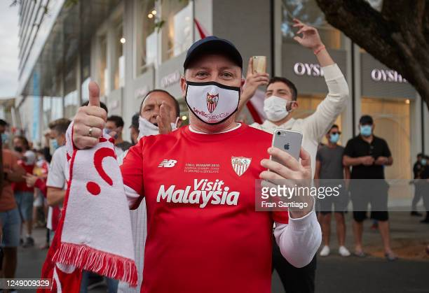 An Sevilla FC supporter cheers prior to the La Liga match between Sevilla FC and Real Betis on June 11, 2020 in Seville, Spain. Spain's La Liga is...