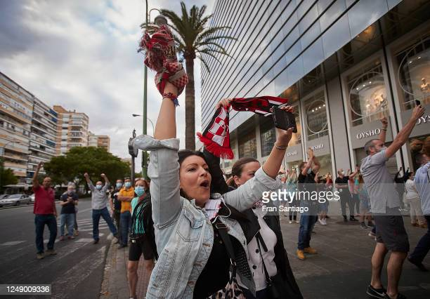 An Sevilla FC supporter cheers prior to the La Liga match between Sevilla FC and Real Betis on June 11 2020 in Seville Spain Spain's La Liga is...