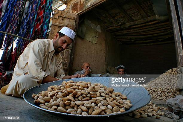 CONTENT] An shopkeeper selling Afghan almonds in Khulm district of Balkh province in Afghanistan