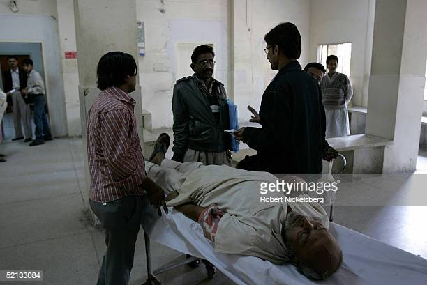 An sick elderly man waits to be admitted into Jinnah Graduate Medical Hospital in downtown Karachi Pakistan January 26 2005 The hospital provides...