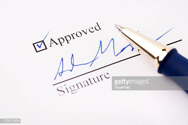 an signature under an approved check mark - permission concept stock pictures, royalty-free photos & images